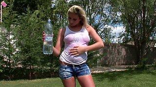 Fantastic solo blonde girl slides a plastic bottle up her cunt