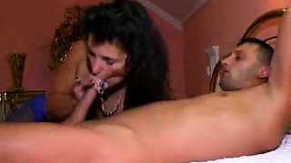 Brunette amateur milf wearing glasses giving handjob