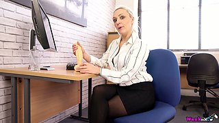 Naughty secretary Amber Deen plays with her favorite sex toy in the office