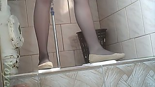 Cute white teen chick in black nylon pantyhose pisses in the toilet