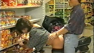 Brunette hot bimbo with hairy pussy sucking and fucking in the supermarket