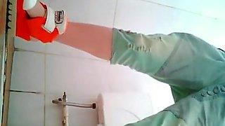 Cute asian spied in public toilet pissing