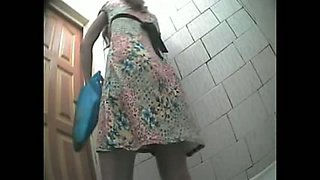 A few girls get caught on a hidden camera in a toilet