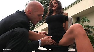 Brunette with fake tits getting her shaved pussy pricked in a close up shoot