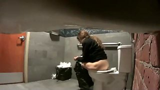 Hidden camera pissing clips from a public toilet