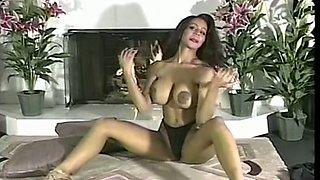 Stunning curvy dark skin brunette with enormous breasts
