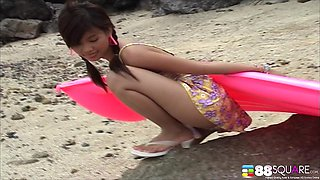 Irresistible Asian babe Katie Chung teases the camera at the beach
