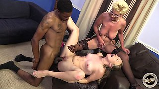 Blond girl and a granny share a black weiner in FFM scene