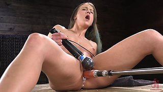 Long haired babe Cheyenne Jewel fucked by a machine on the table