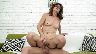 Sexy granny Mayna May sucks young dick and hops on it in reverse riding pose