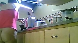 LATINA MATURE NUDE KITCHEN