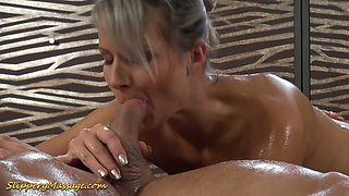 Gorgeous big breasted grey haired masseuse Holly gives head during slippery massage