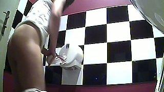 Fine brunette amateur hottie in white panties filmed in the toilet
