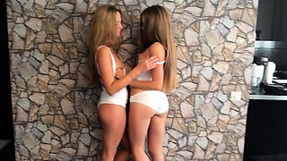 Two beautiful young lesbians passionately kissing each other
