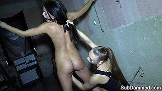 Lesbian femdom flogging restrained slave babe
