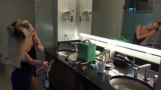 Petite young blonde showers and pleasures her self
