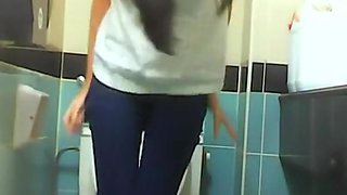 Brunette spied in public toilet pissing