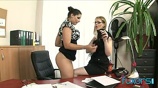 Whorish secretary and sex-hungry book keeper fuck each other on the boss's table