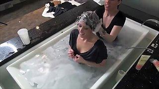 Girlfriens in bathtub clothes