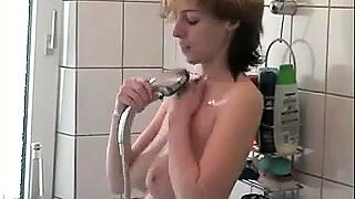 Big breasted amateur milf shaves her pussy and masturbates