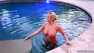 Delicious blond fuck doll plays with her juicy tits right in pool