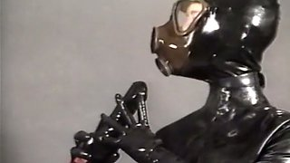 Insane fetish action with two sluts in latex body and gasmasks