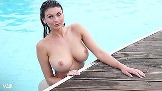Fucking hot seductress Lucy is stripping by the poolside
