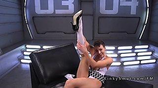 Babe takes off stockings and fucks machine
