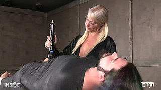 Attractive mistress London River punishes tied up man in the BDSM room