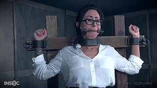 Submissive Lily Lane strapped to a pole and abused with electricity