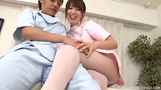 Nurse in soft pink pantyhose gives the doctor a footjob