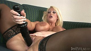 Tanned and horn-mad blondie uses a gigantic sex toy for pleasing her mature twat