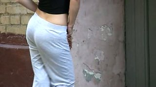 Beautiful skinny brunette teen pisses in her yoga pants