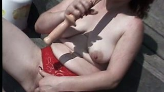 Just ordinary ugly fat amateur whore who uses a dildo to masturbate at yard