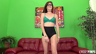 Small titty brunette with glasses cure her boredom with a huge purple dildo in a solo shoot