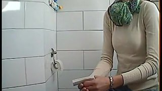 Skinny maid goes pee in toilet cam footage