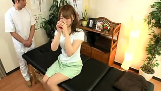 Lovely Asian babe is made to cum hard on the massage table