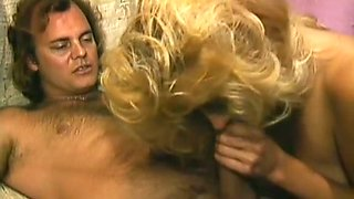 Sweet and insatiable blonde milf in black dress gives head