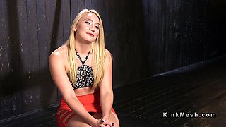Blonde tart gets tied up to a spanking and stretching construction and abused with a large dildo