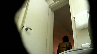 Chubby Asian student chick takes a piss on hidden cam