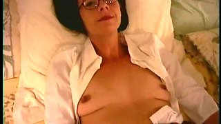Hot brunette in glasses and miniskirt toy fucking her cunt