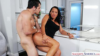 Ample breasted mommy Lezley Zen fucks her stepson in the kitchen