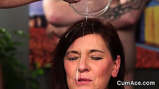 Horny bombshell gets jizz shot on her face eating all the sp