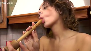 inga drills her hairy pussy with a wooden masher in a kitchen