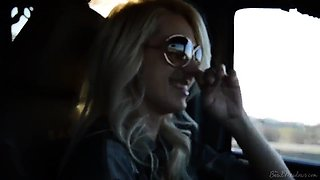 Gorgeous blonde with lovely tits drills her pussy in the car