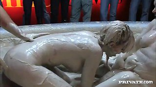 kinky ladies have a threesome with a guy in pool filled with mud