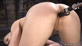 Blonde gets machine in pussy and asshole