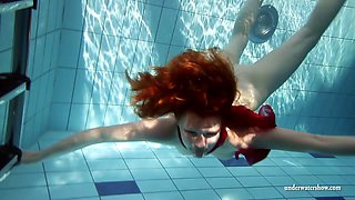 Perfect Russian redhead showing her pussy in the local pool