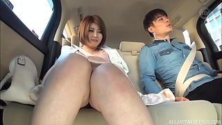 Busty Japanese teen gets her pussy fingered on the back seat of a car