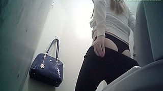 Cute white blonde teen in black panties filmed in the toilet